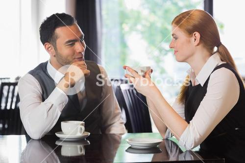 Business people talking over coffee