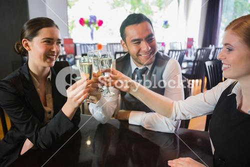 Three business people toasting their success