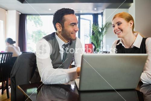 Happy business people working together