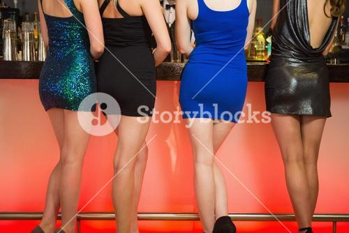 Sexy women legs standing at bar