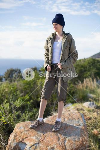 Woman standing on a rock wearing a beanie hat
