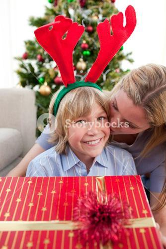 Loving mother kisses son at Christmas