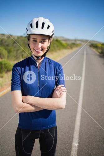 Woman with helmet crossing arms