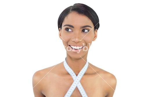 Smiling natural model with measuring tape around her neck