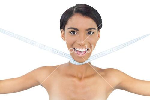 Cheerful natural model with measuring tape around her neck
