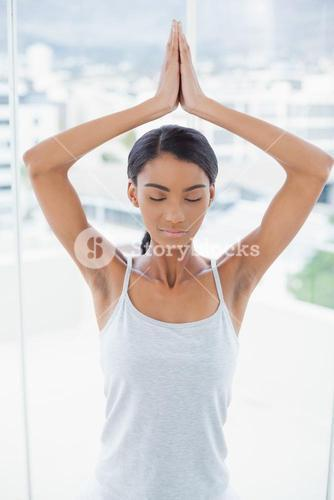 Relaxed gorgeous model doing yoga exercise