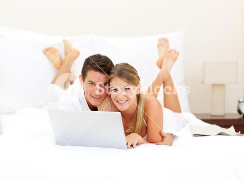 Happy couple surfing the internet