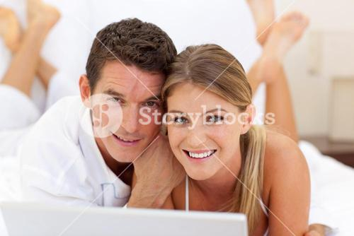 Close up of a couple surfing the internet