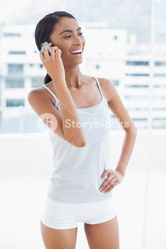 Smiling sporty model on the phone