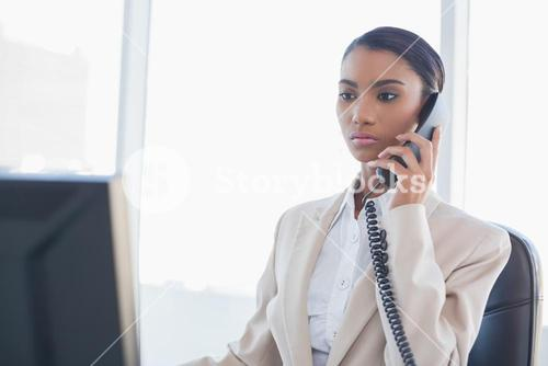 Stern gorgeous businesswoman on the phone