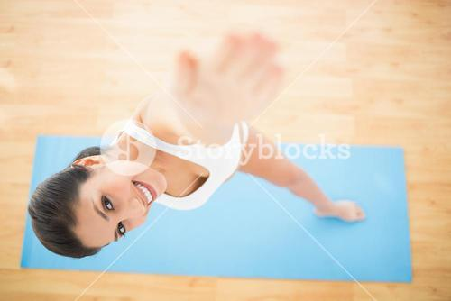 Happy woman stretching in extended side angle pose