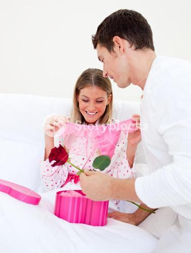 Charming husband giving a present to his wife