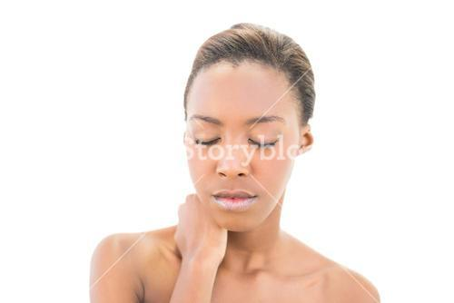 Natural beauty with hand on neck and closed eyes