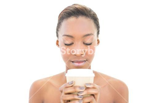 Natural beauty with closed eyes and coffee cup