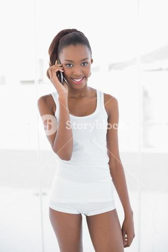 Fit smiling woman on the phone