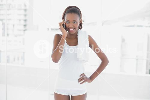 Peaceful fit woman having a phone call