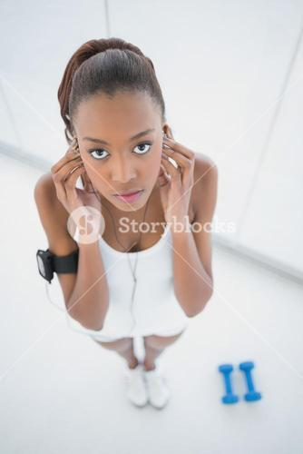 High angle view of relaxed fit woman listening to music