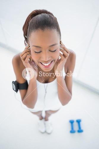 High angle view of peaceful fit woman listening to music