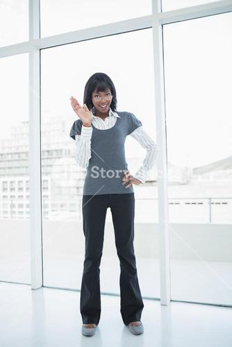 Smiling businesswoman waving