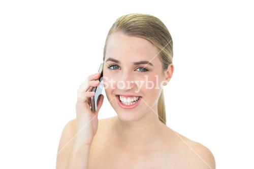 Happy attractive blonde on the phone