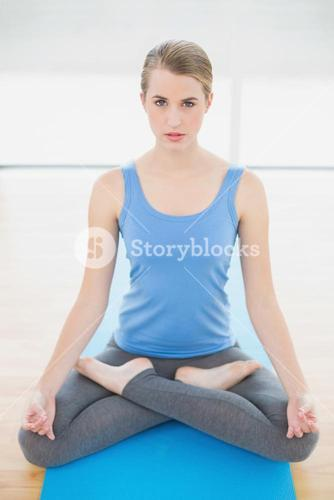 Attractive blonde relaxing in lotus position