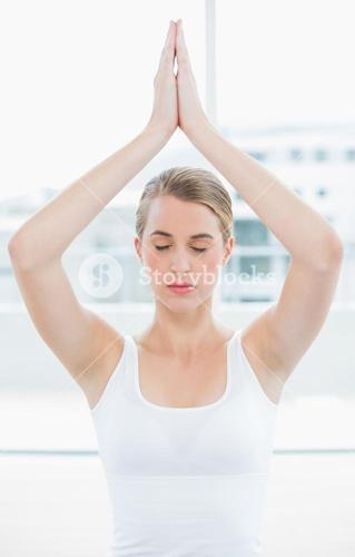 Peaceful fit woman doing yoga session