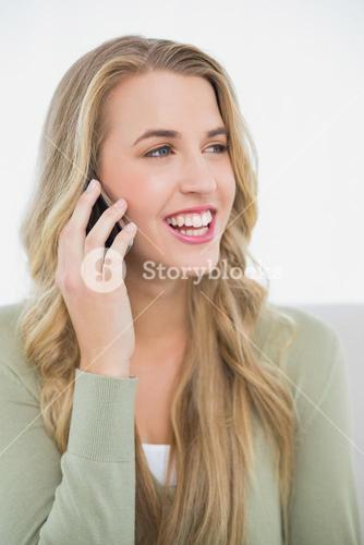 Smiling pretty blonde on the phone