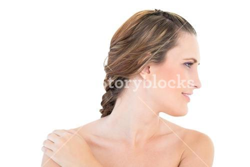 Smiling woman with hand on shoulder posing