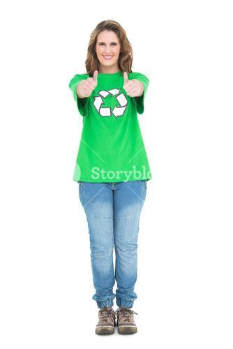 Woman wearing green tshirt with recycling symbol giving thumbs up