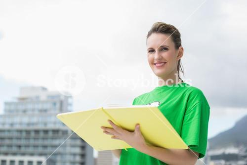 Smiling activist holding notebook