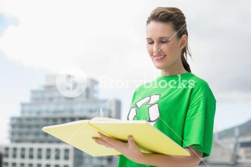 Smiling activist with recycling tshirt reading