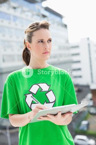 Thoughtful activist holding clipboard