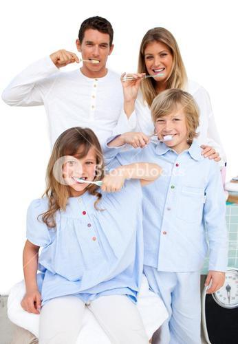 Family Washing Their Teeth