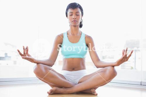 Relaxed black haired woman doing yoga