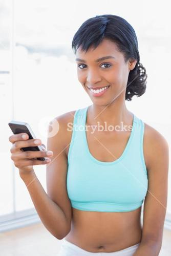 Content fit woman texting with her mobile phone