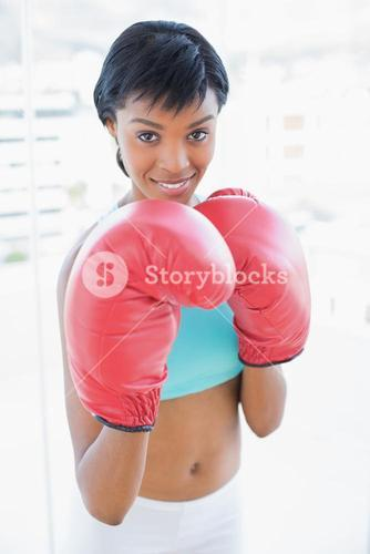 Content black haired woman boxing the camera