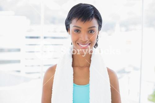 Content black haired woman wearing a towel around her neck