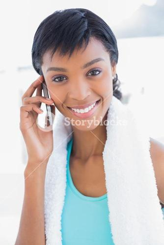 Gorgeous black haired woman calling someone with her mobile phone