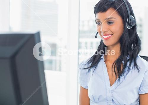 Smiling operator looking at her computer