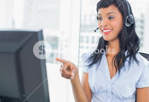 Pretty operator pointing her computer