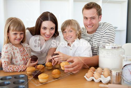 Smiling family eating their muffins