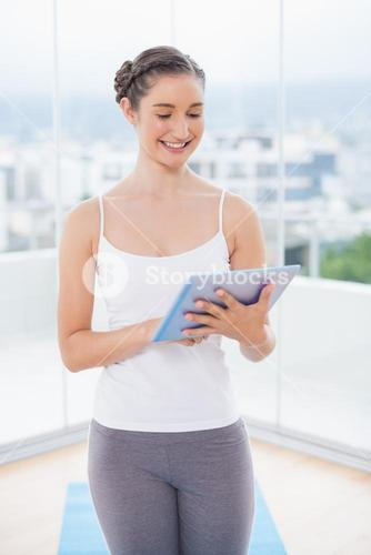 Happy sporty model scrolling on tablet pc