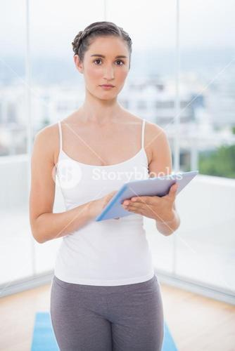 Serious sporty model scrolling on tablet pc