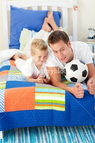 Handsome father and his son playing with a soccer ball