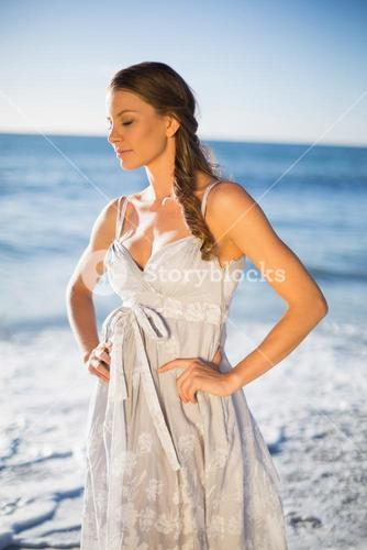 Attractive woman in summer dress posing