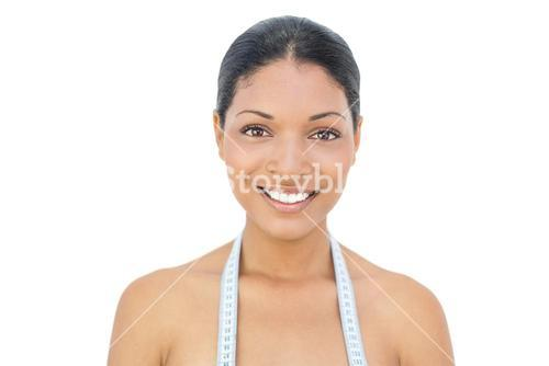 Cheerful black haired model wearing measuring tape
