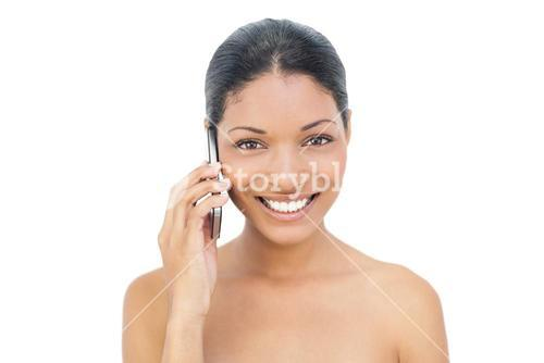 Smiling black haired model on the phone