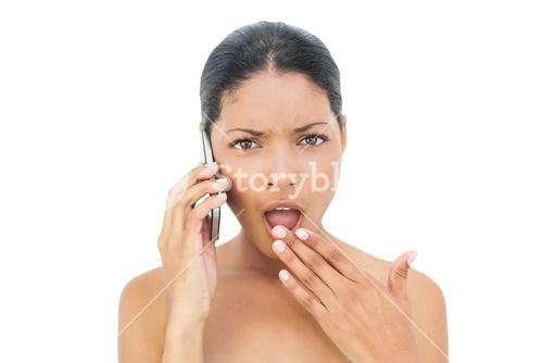 Shocked black haired model on the phone