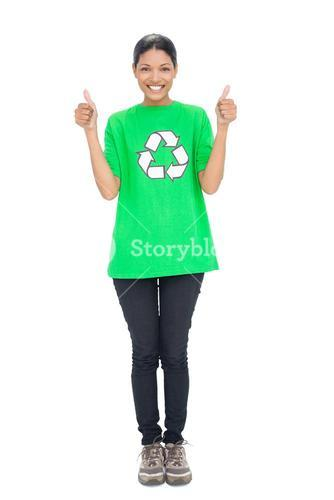Cheerful black haired model wearing recycling tshirt giving thumbs up