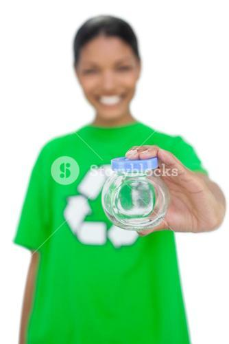 Cheerful model wearing recycling tshirt holding pot